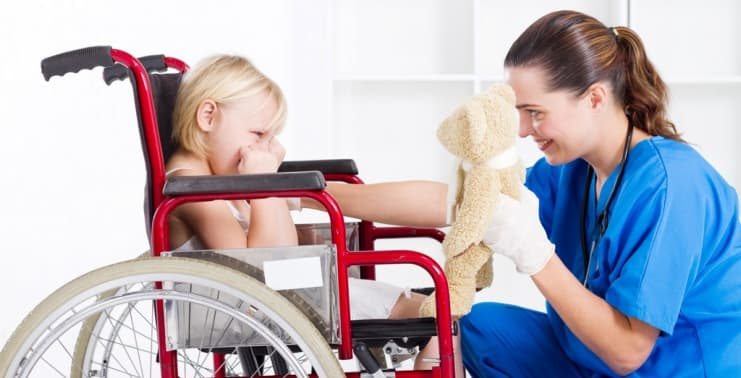 kid and caregiver smiling