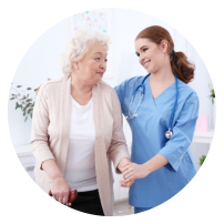 senior woman assisted by caregiver
