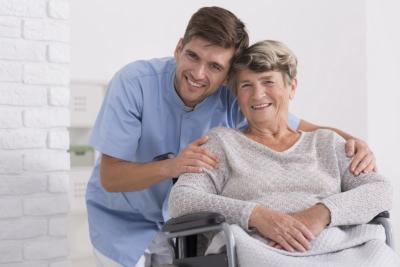 caregiver and senior woman smling