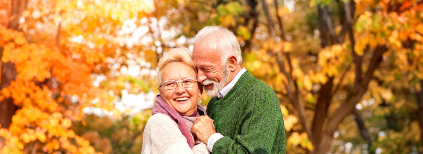 elderly couple under the autumn trees