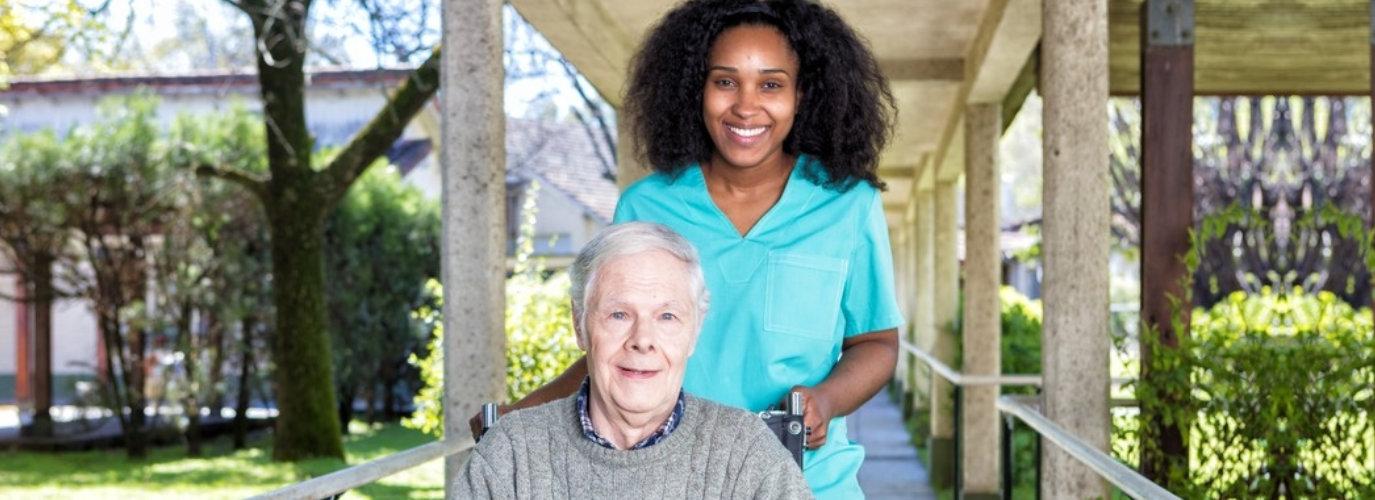 caregiver and senior woman outsite senior home